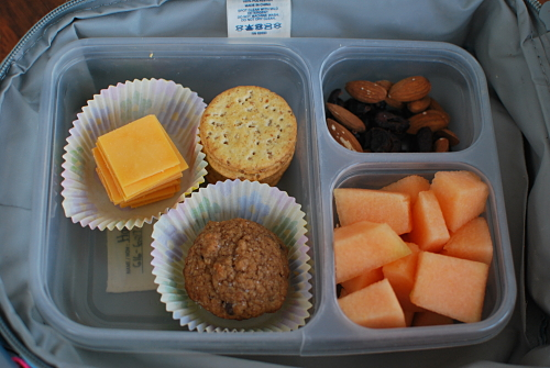 Cheese and Crackers, Mini Banana Chocolate Chip Muffin, Dried Cranberries and Almonds , Cantaloupe Chunks