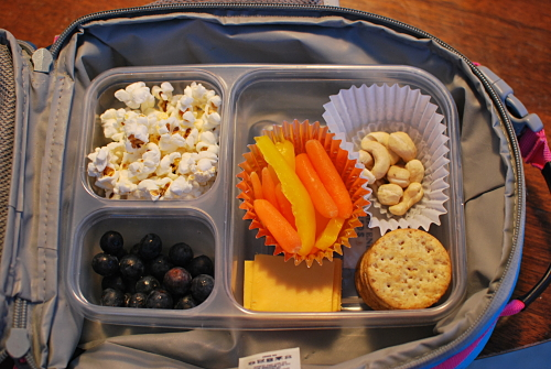 Popcorn, Carrots and Yellow Bell Pepper strips, raw cashews, cheese and crackers, blueberries