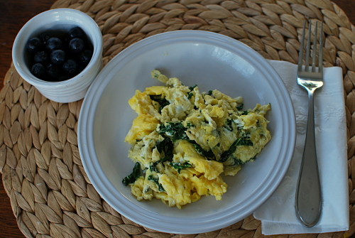Breakfast for Dinner - scrambled eggs with kale and blueberries on the side