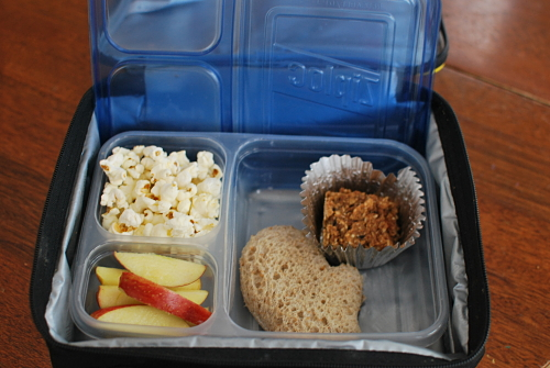 All Natural Peanut Butter and Jelly on Whole Wheat (shaped like a mitten), apple slices, popcorn, and Carrot Cake Oatmeal Square