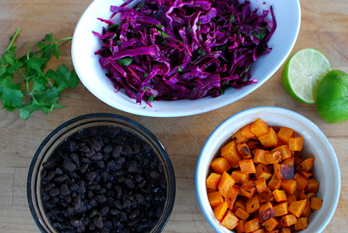 ... sweet potatoes, a tangy purple cabbage slaw, and some fresh guacamole
