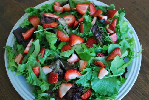 baby greens with strawberries