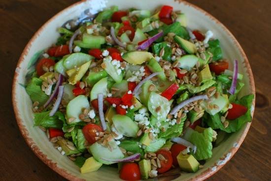 salad with cuke, red pepper, tomato, avocado, sunflower seeds, feta