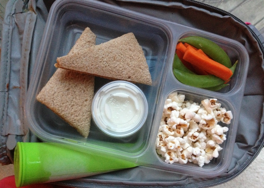 PB&J on whole wheat, carrots & peapods with homemade Ranch dip, popcorn, strawberry mango smoothie puree frozen in a silicon popsicle mold.